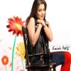 Amisha On Chair Bollywood 400x300