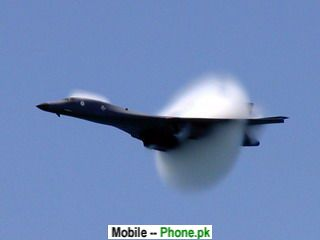 smoke_fighter_jet_320x240_mobile_wallpaper.jpg